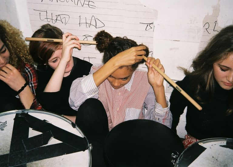 Girls with drumsticks